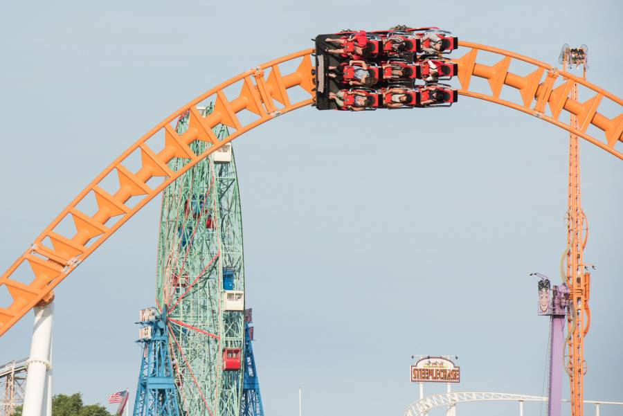 People riding the Thunderbolt in Coney Island