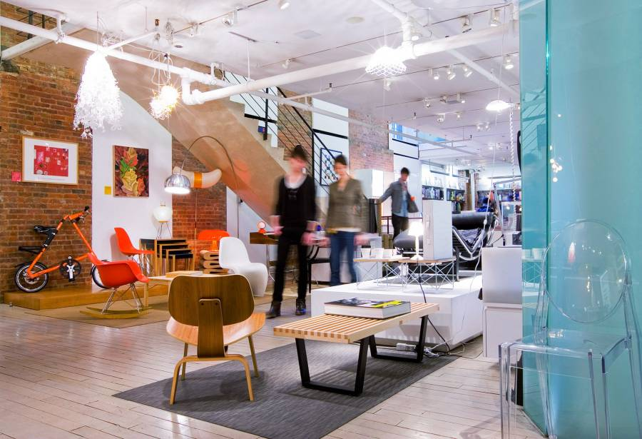 Shoppers in the interior of the MoMA Design Store in Soho.