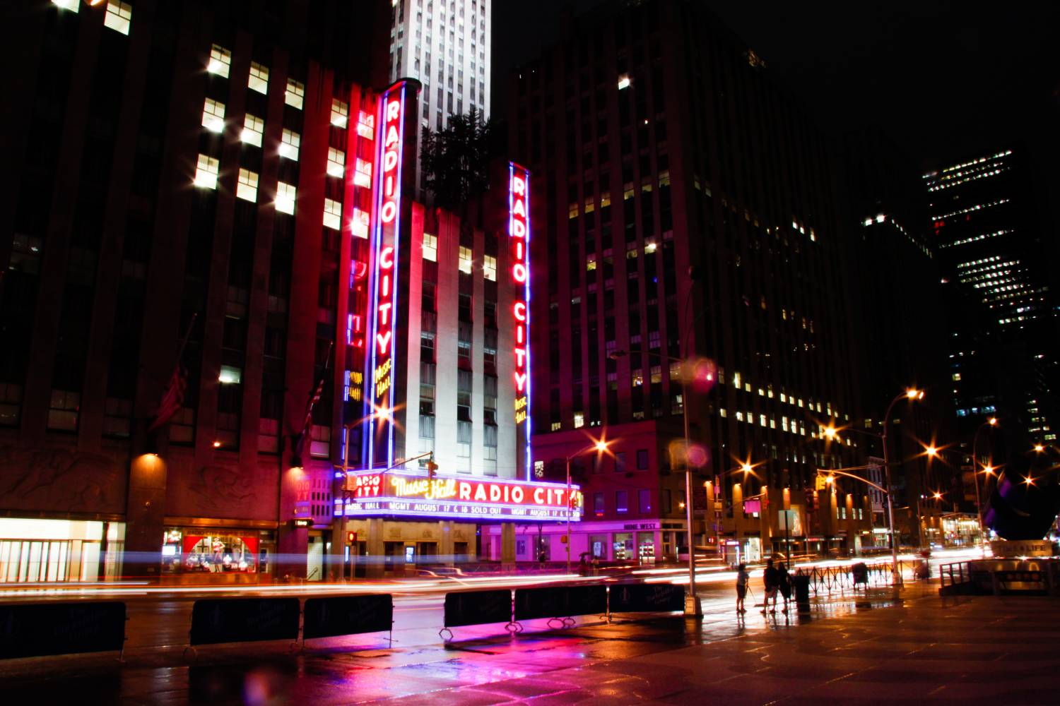 Exterior of Radio City Music Hall at night with fountain