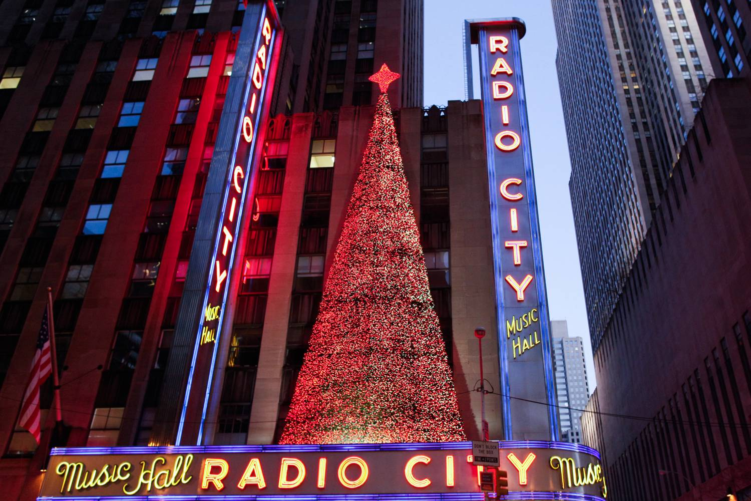Exterior of Radio City Music Hall during the Christmas season with Christmas tree at dusk
