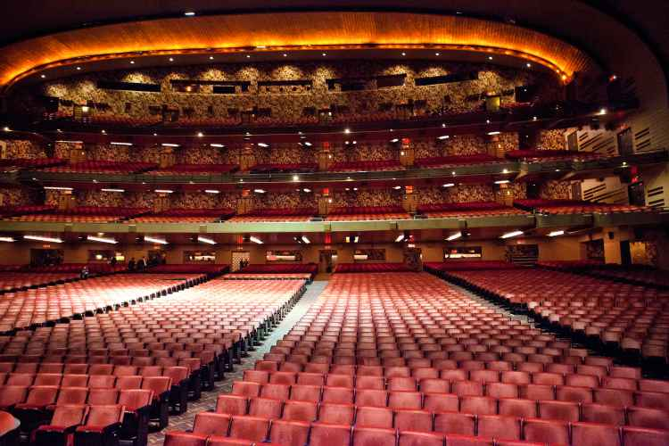 Interior of Radio City Music Hall looking from the stage at the seats in the auditorium