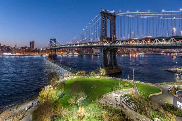 Brooklyn Bridge Park at night with a view of the Brooklyn Bridge