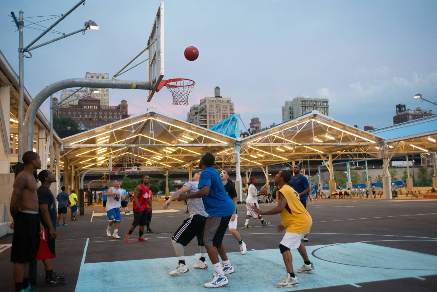 People playing basketball at Brooklyn Bridge Pier