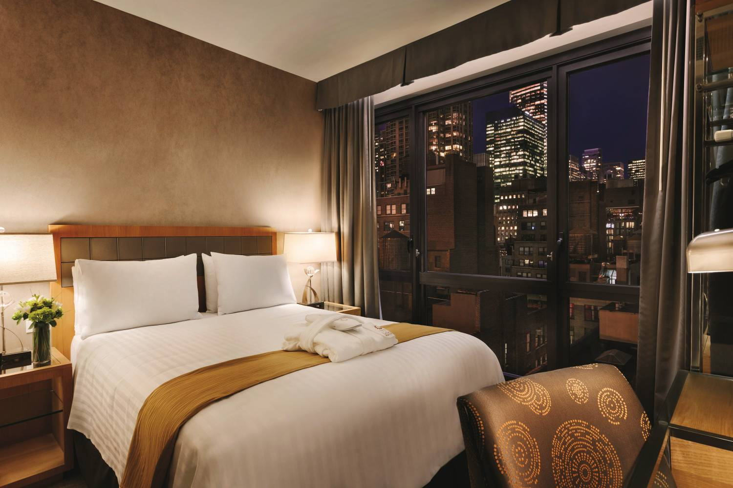 Queen bedroom with view of Manhattan at Executive Hotel LeSoleil in Midtown West