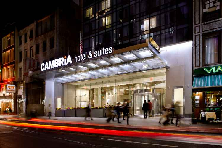 exterior of Cambria Hotel & Suites New York Times Square at night