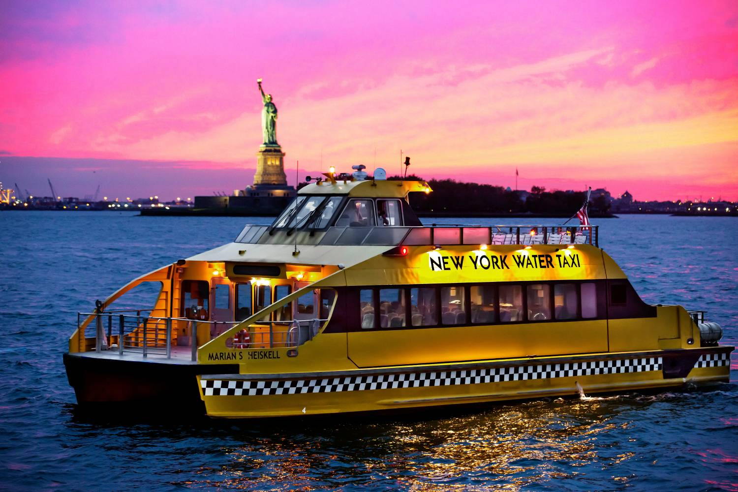 New York Water Taxi statue of liberty at dusk
