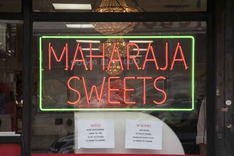 Maharaja Quality Sweets and Snacks, sign