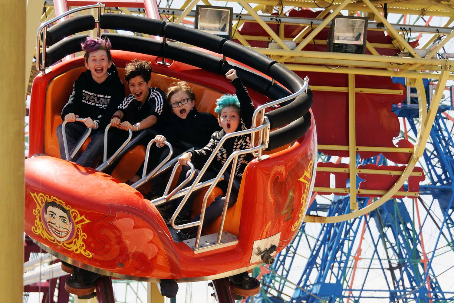 kids enjoy a thrilling ride at Luna Park in Coney Island Brooklyn