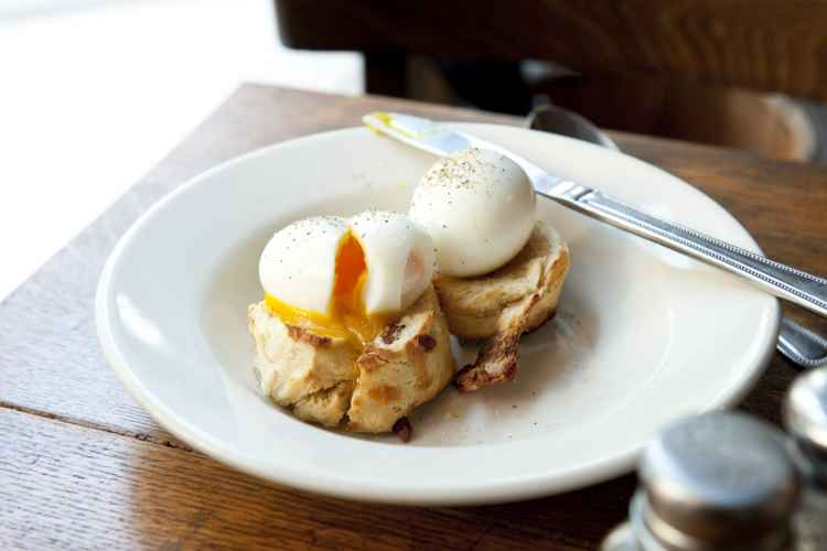 poached eggs on a biscuit at Iris Cafe in Brooklyn Heights