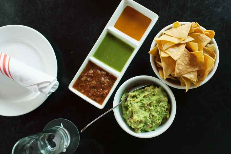 Guacamole and homemade chips and trio of salsas at El Toto Blanco in Manhattan
